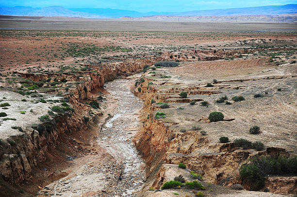 Dry lake Dried river in Morocco. riverbed stock pictures, royalty-free photos & images