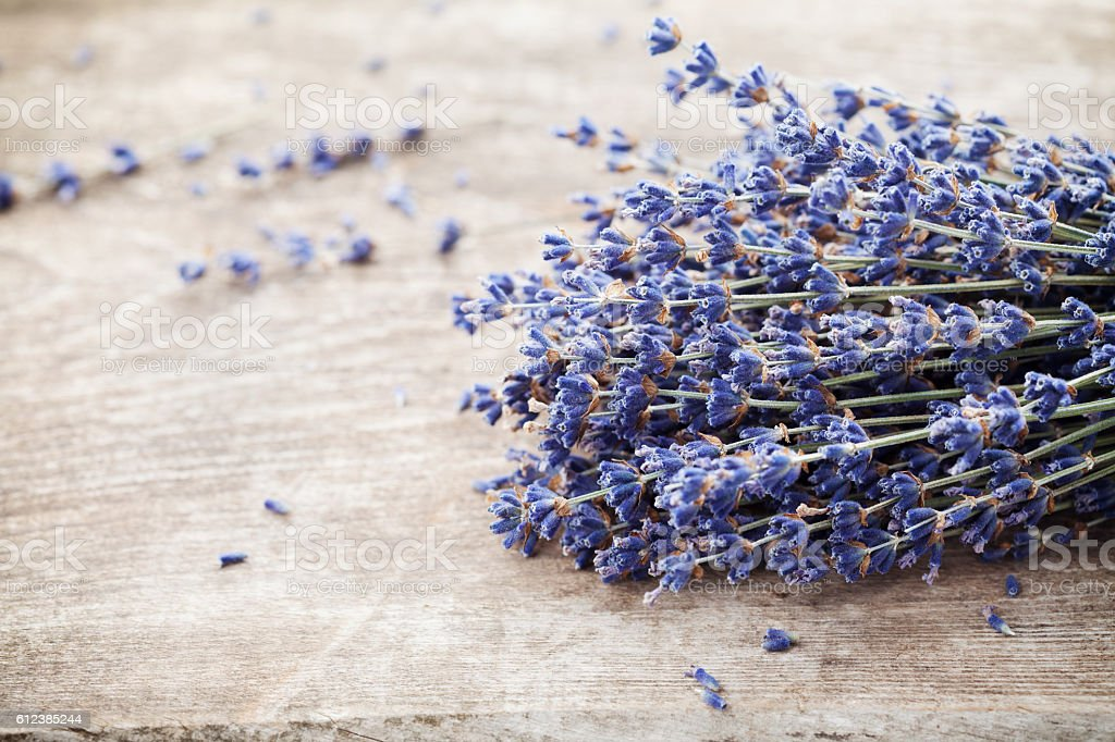Dry lavender heap on vintage wooden table. Rustic style. stock photo