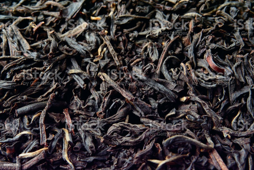 Hojas secas de té negro. Close-up. - Foto de stock de Abstracto libre de derechos