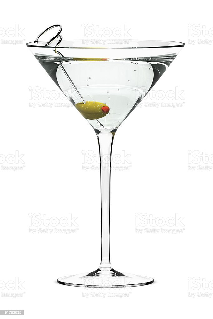 A dry martini with a green olive stock photo