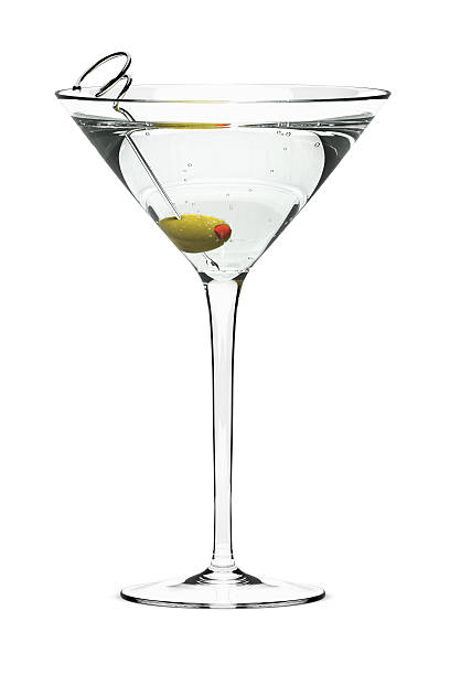 A dry martini with a green olive Martini with olive on fancy skewer, isolated on white. Includes pro clipping path. martini glass stock pictures, royalty-free photos & images