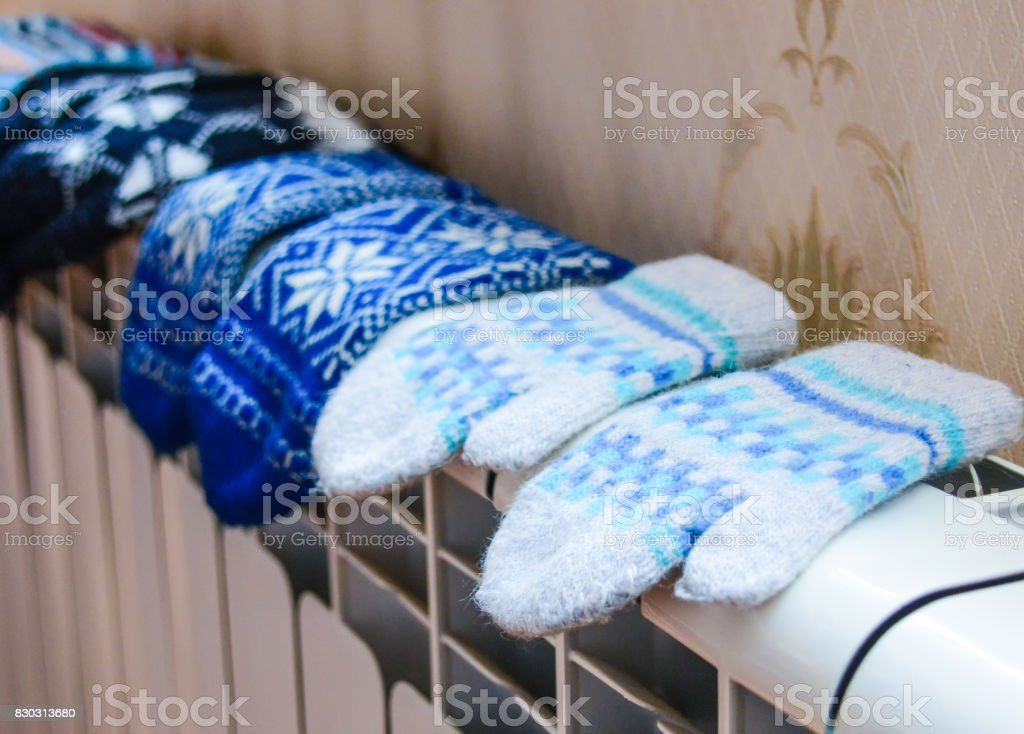 Dry mittens on the radiator stock photo
