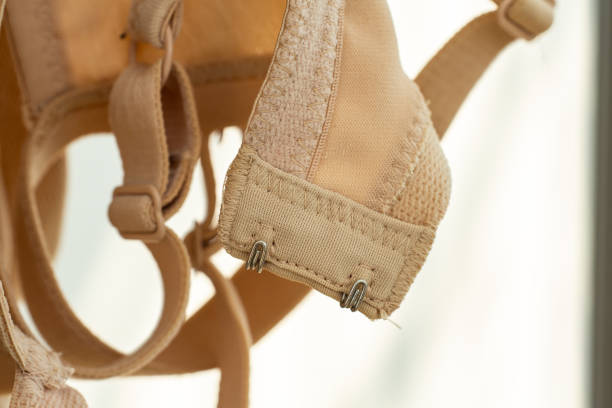 Dry old bras in the sun, Blurred background, Close up & Macro shot, Selective focus Dry old bras in the sun, Blurred background, Close up & Macro shot, Selective focus bra stock pictures, royalty-free photos & images
