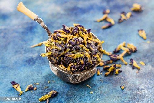 Dry pea flowers. Organic thai butterfly pea tea on blue background
