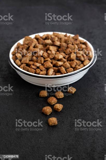 Dry pet food in a white ceramic bowl on black background with copy picture id1243486476?b=1&k=6&m=1243486476&s=612x612&h=cnfubwh n9a6psug1t5adlf40qcqcbo8csxfnyodfno=