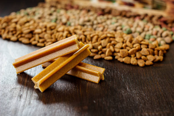 Dry pet food on black wooden table. stock photo