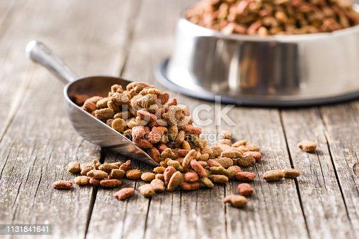Dry pet food. Dry kibble food in scoop.