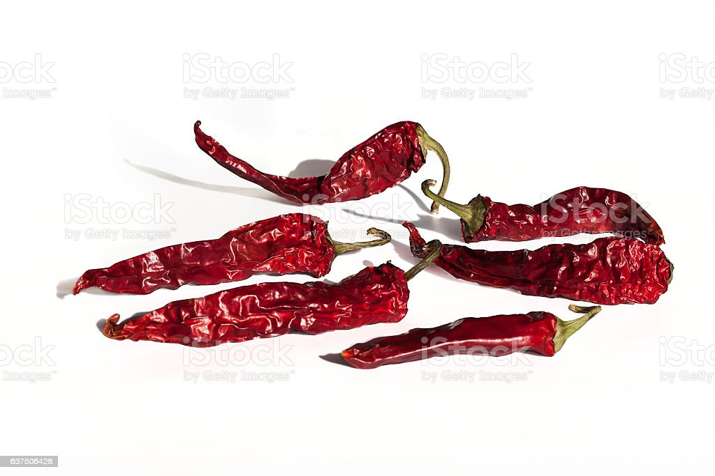 dry red chili pepper isolated on white background stock photo