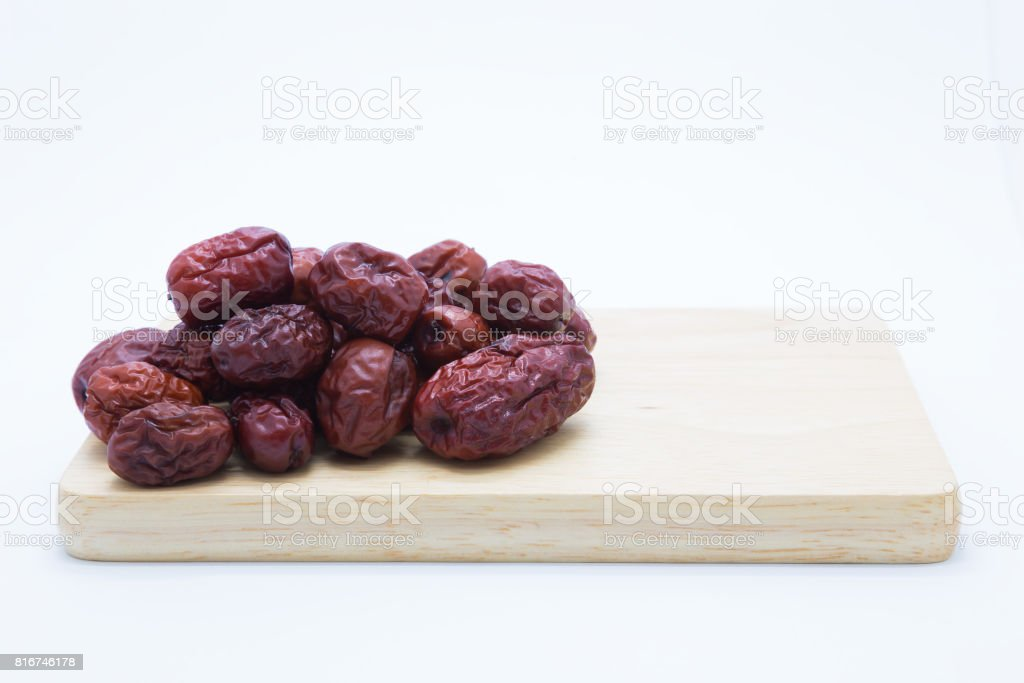 Dry red Jujube fruit on wooden board stock photo