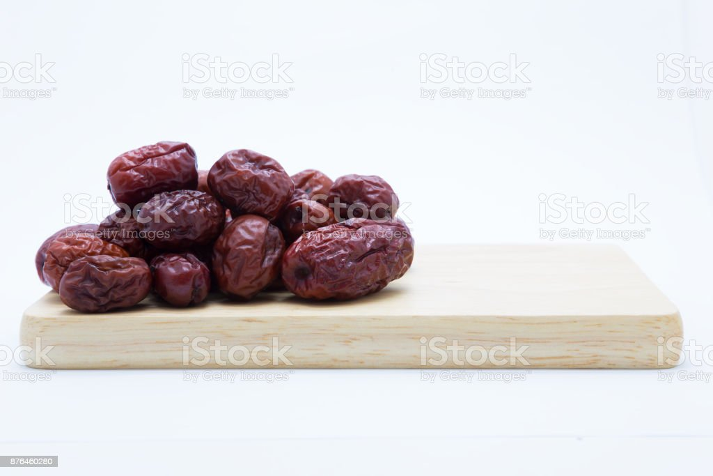 Dry red jujube on wooden board stock photo