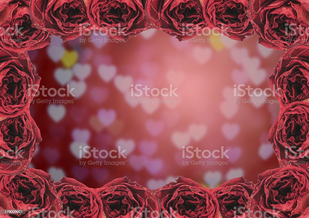 dry red rose frame on blur heart bokeh background royalty-free stock photo