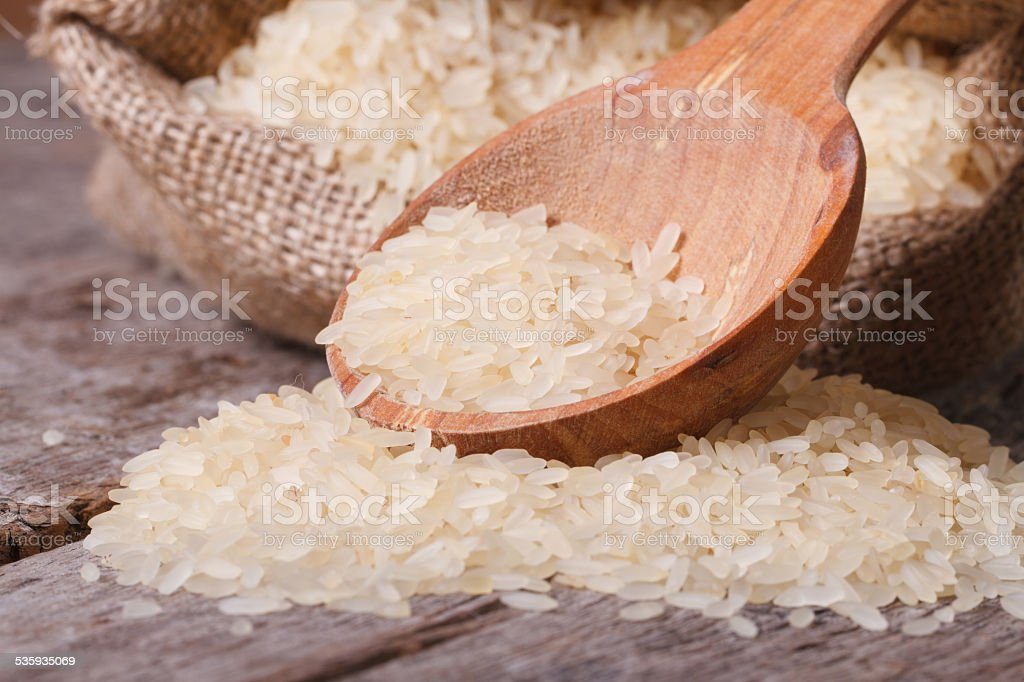 dry rice macro spill out of bag on the table stock photo