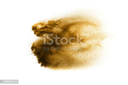 1131317595 istock photo Dry river sand explosion. Golden colored sand splash against white background. 1058832044