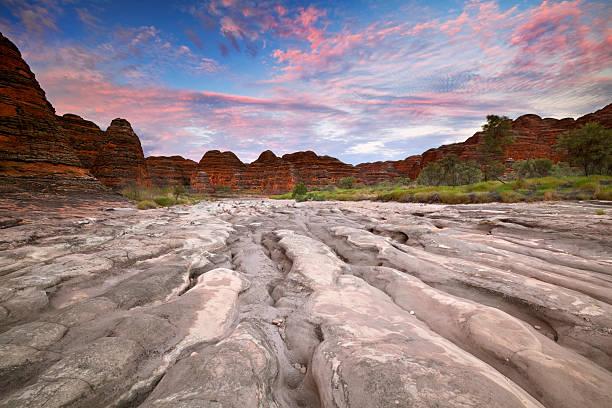 Dry riverbed in Purnululu National Park, Western Australia at sunrise stock photo