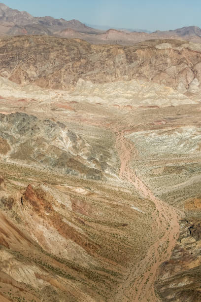 Dry riverbed leading to red rock mountains. stock photo