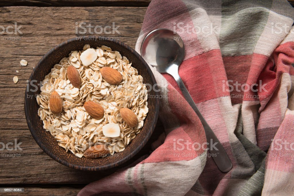 Dry rolled oat flakes oatmeal on old wooden zbiór zdjęć royalty-free