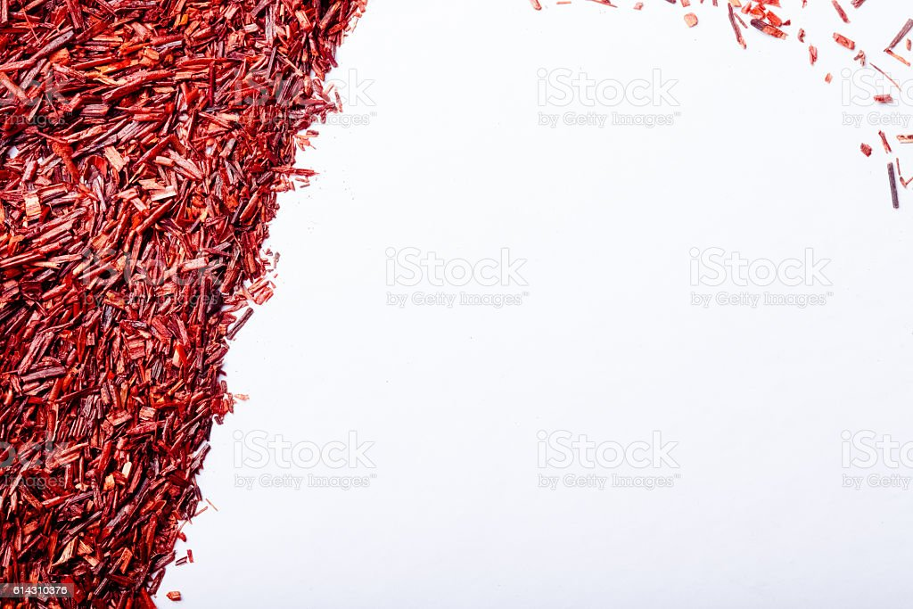 Dry rooibos tea leaves as texture for background. Toned stock photo