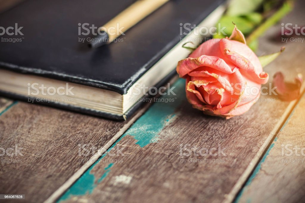 Dry rose on the wooden. - Royalty-free Backgrounds Stock Photo