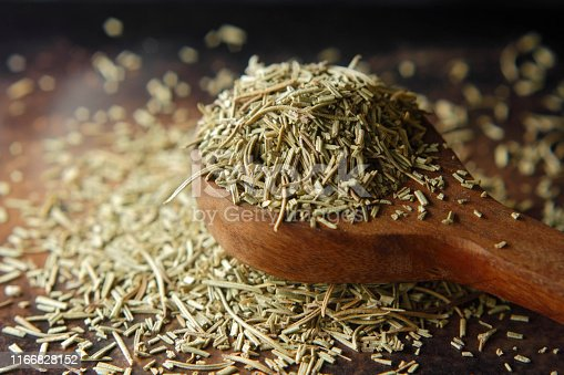 Dry rosemary spice on dark. Macro with shallow depth of field.