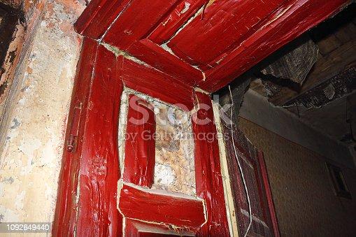 656168432 istock photo dry rot on door frame 1092649440