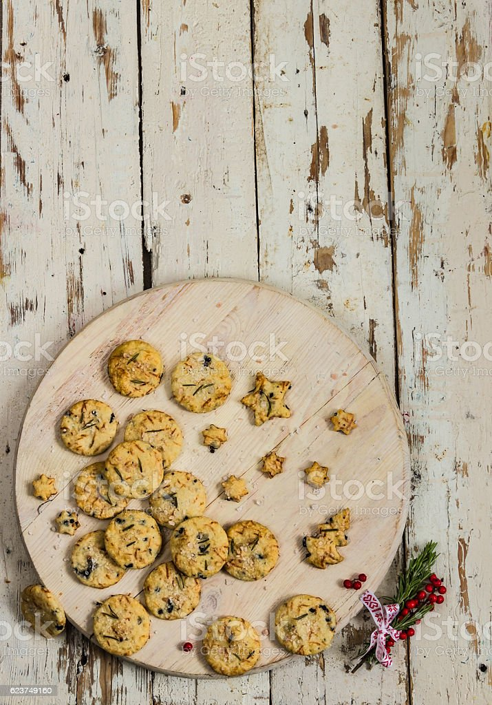 dry salted crackers on wooden plate with rosemary stock photo