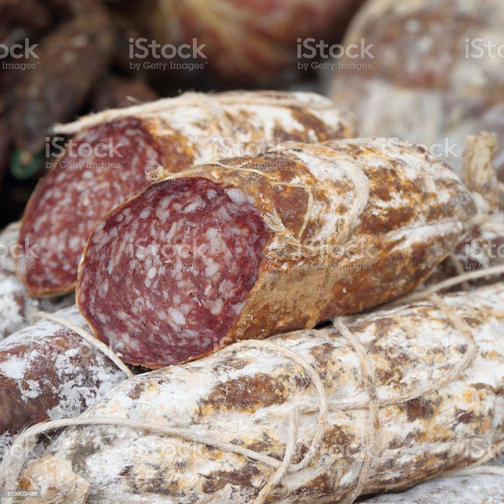 dry sausage display stock photo