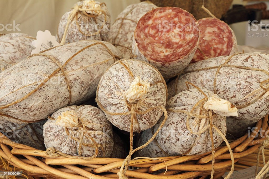 dry sausage in basket stock photo