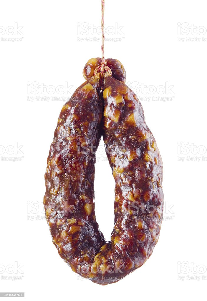 Dry sausage is hanging on hook isolated stock photo