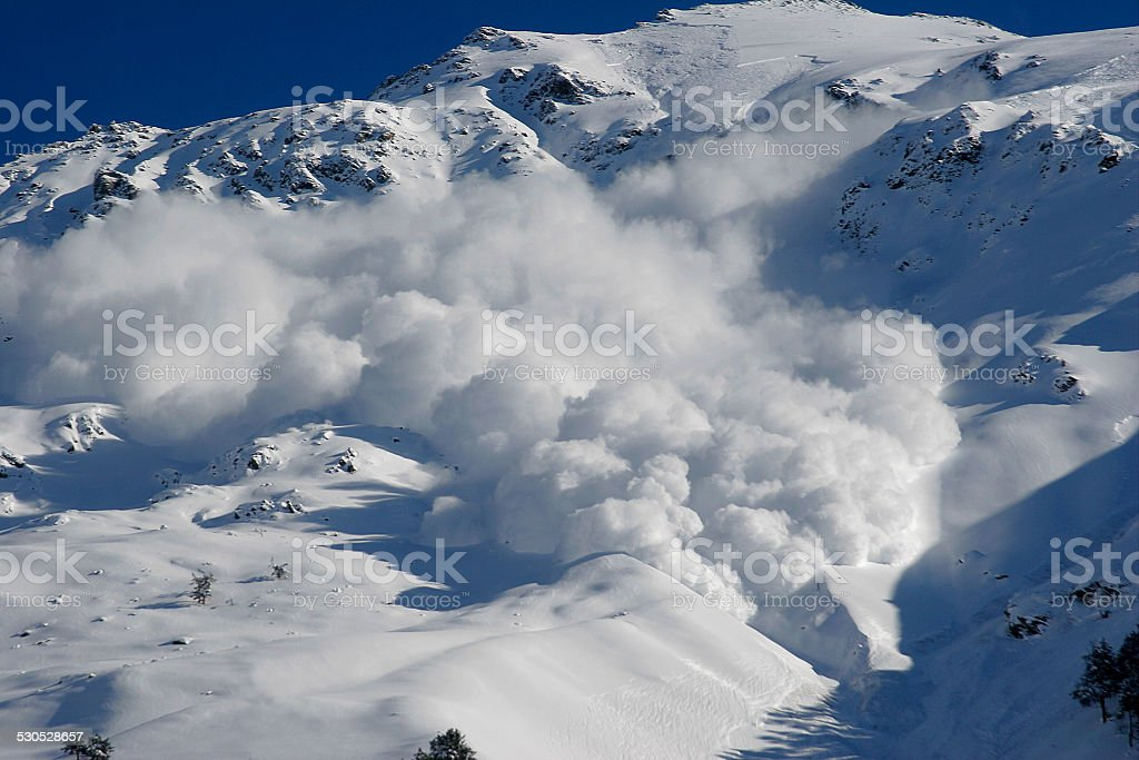 Dry snow avalanche with a powder cloud.Caucasus. royalty-free stock photo