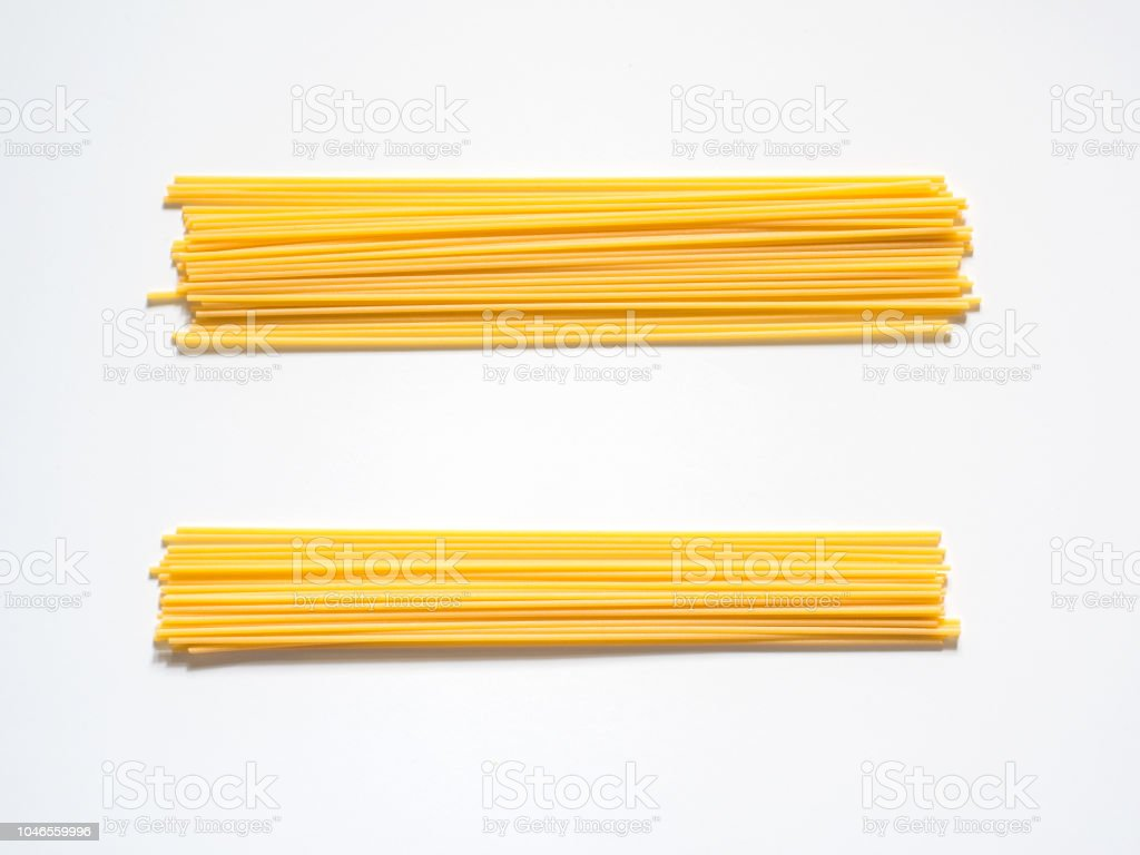 Dry spaghetti on a white background for the menu. Geometric background. Flat lay, copy space, top view - Foto stock royalty-free di Alimentazione sana