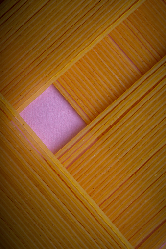 dry spaghetti on pink background ,close up ,graphic design