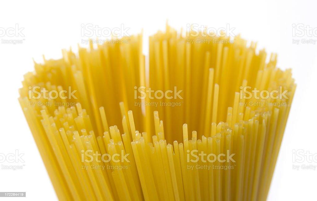 Dry Spaghetti Pasta Noodles, Food of Italian Cuisine on White royalty-free stock photo