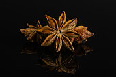 istock Dry star anise isolated on black glass 1172213270