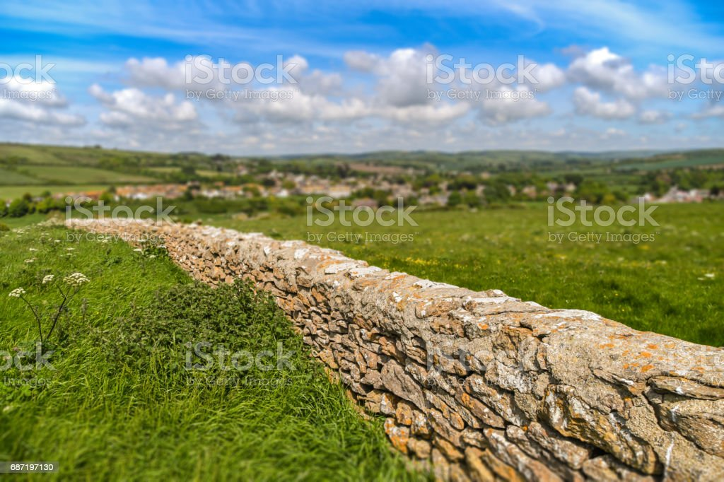 Dry stone wall in countryside stock photo