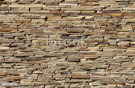 Dry stone wall texture background close up