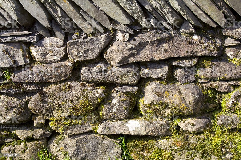 Dry stone wall with moss royalty-free stock photo