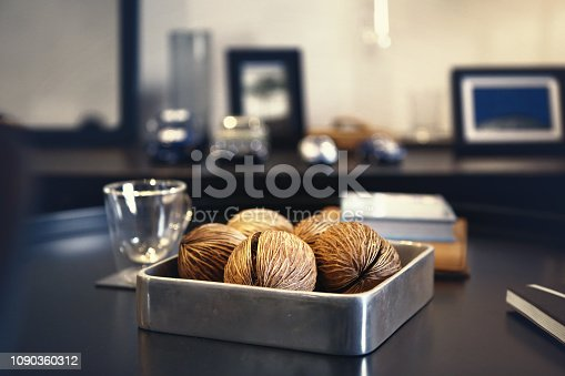 istock dry suicide tree seeds in a metal tray 1090360312