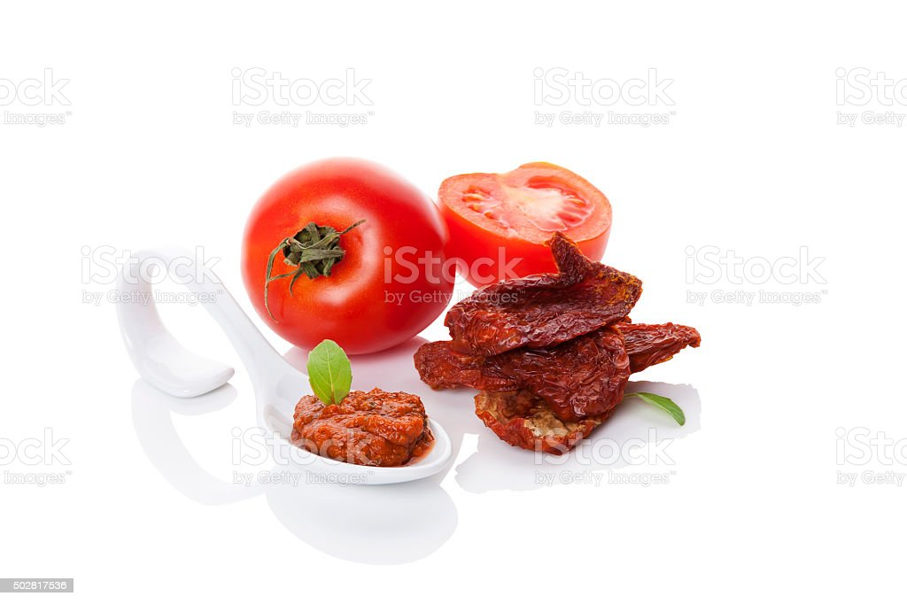 Dry tomatoes and red pesto. stock photo