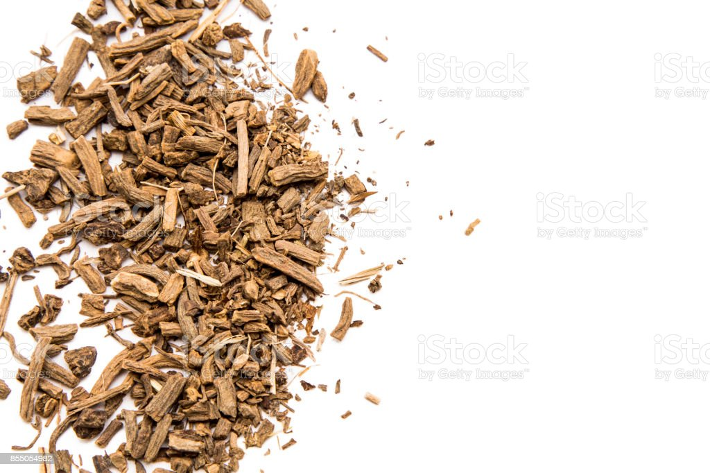 Dry Valerian root on white background stock photo