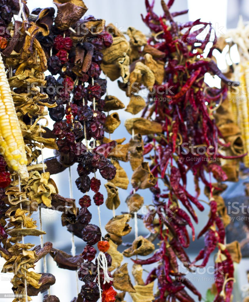 Dry vegetables and spices on ropes stock photo