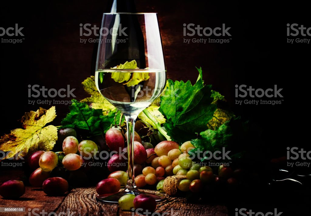 Dry white wine in glass stock photo