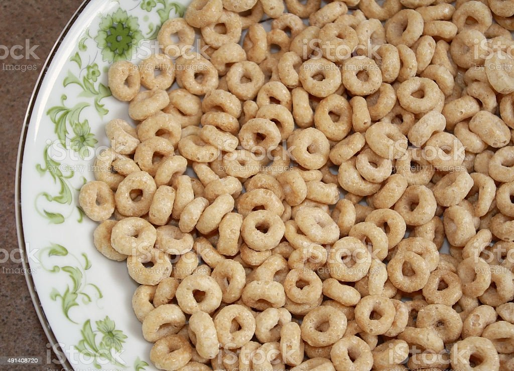 Dry wholegrain cheerios in a cereal bowl stock photo
