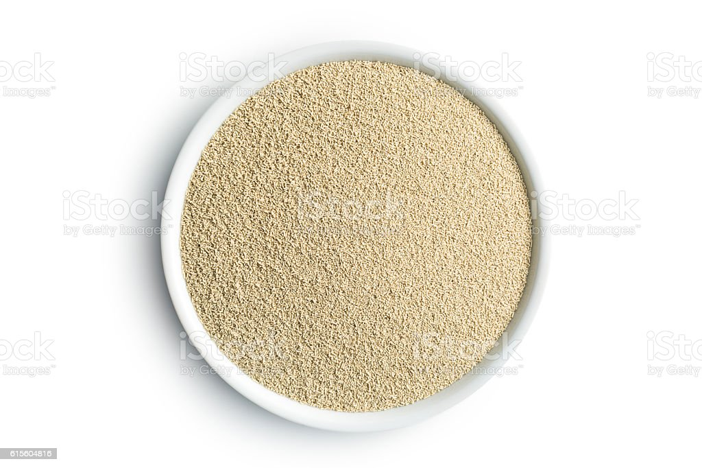 dry yeast in bowl stock photo