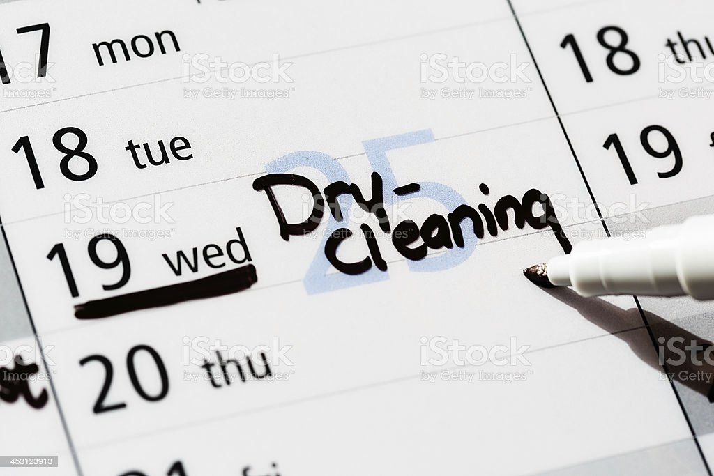 Dry-cleaning marked for Wednesday in diary royalty-free stock photo