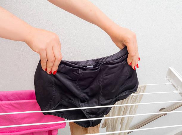 027b824b99 Drying big black shape wear panty girdle on clothes horse stock photo