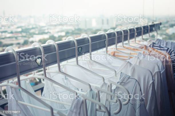Drying clothes on clothesline on condo in morninghousework and picture id1127275927?b=1&k=6&m=1127275927&s=612x612&h=b84hnclmetiypatgrwvks3d ila88st jwgeprrxudw=