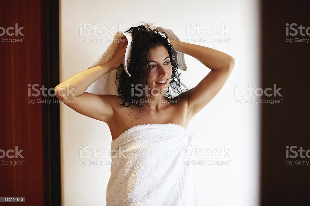 Drying her hair after a long shower royalty-free stock photo