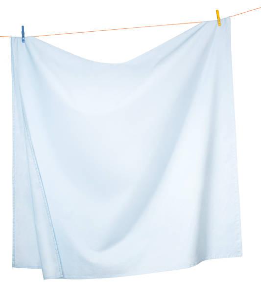 Drying Linen sheets stock photo