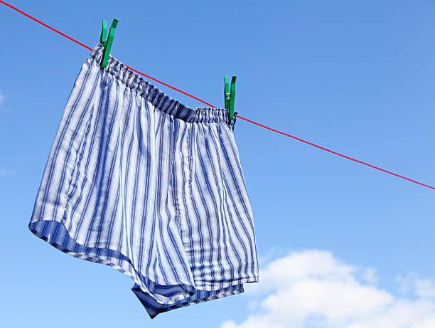 trocknen boxershorts für herren - horizontal gestreiften vorhängen stock-fotos und bilder