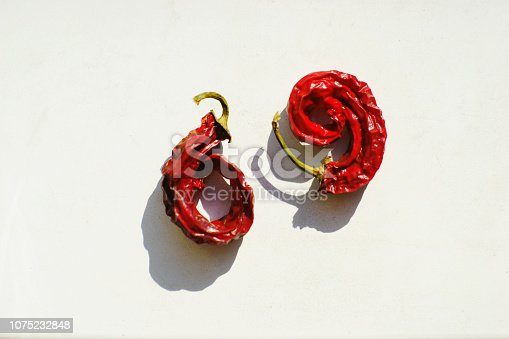 184343107 istock photo 69 drying peppers cute red numbers on white background 1075232848